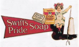"(Opposite page) A rare string holder for Swift's Pride Soap. Though the pig-tail girl looks more contemporary, this piece is dated 1908. H.D. Beach, Coshocton, OH. Two-sided and 30"" wide. Only two known in existence."