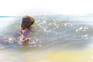 little girl in wave